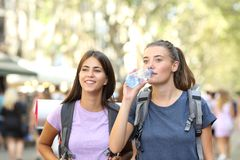 Backpackers sightseeing walking on vacation in the street stock photography