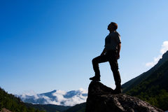 Backpackers silhouette Stock Photos