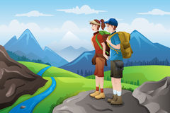 Backpackers on top mountains Stock Images