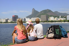 Backpackers tourists in Rio de Janeiro looking at Christ the Redeemer. royalty free stock photography