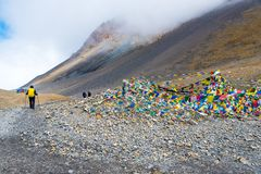 Backpackers on trekking path at Thorang-la pass, Annapurna Conservation Area, Nepal royalty free stock image