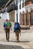 Backpackers walk through Villa de Leyva Stock Photography