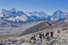 Backpackers walking in the Himalayas Stock Image