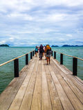 Backpackers walking on a pontoon Royalty Free Stock Image