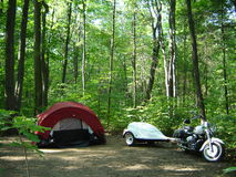 Backpacking in canadian forest. With a motocycle Royalty Free Stock Photo