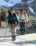 Backpacking Couple at End of Long Hike Royalty Free Stock Photography