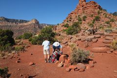 Backpacking couple in the Grand Canyon. Backpacking couple preparing for the day`s hike on Horseshoe Mesa in Grand Canyon National Park, Arizona stock image