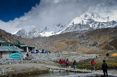 Backpacking in the Himalayas. Backpackers hiking in the small village of Lobuche in the Everest base camp trek in Nepal Royalty Free Stock Images