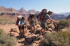 Backpacking sisters on the Tonto Trail in the Grand Canyon. Backpacking sisters on the Tonto Trail during a multi-day hike in Grand Canyon National Park stock images