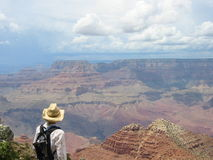 Backpacking tour. Woman backpacker looking over Grand Canyon Royalty Free Stock Photos
