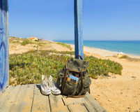 Backpacking traveller in a beach rest. Tavira island, Algarve. Portugal. Backpack and shoes on the porch of a wooden hut next to the shore of a European beach stock images