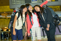 Backpacking Travellers. Three girls posing for a farewell group shot at the airport before departing for a holiday stock photos