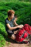 Backpacking. Vertical image of a young tourist backpacking in the forest royalty free stock photos