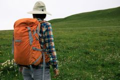 Backpacking woman hiking Royalty Free Stock Image