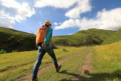 Woman hiking in prairie mountains Stock Photography