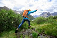 Backpacking woman jumping Stock Photography