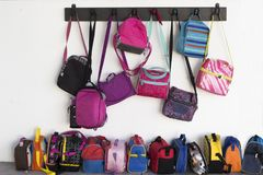 Backpacks. Colorful backpacks in a school Stock Photography