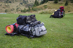Backpacks on grass. Mountains top Royalty Free Stock Photography