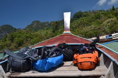 Backpacks on longtail boat. Backpacks on a prow of longtail boat in thailand Royalty Free Stock Photography