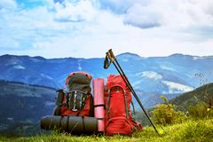 Backpacks in the mountains overlooking the mountains on the gree. Backpacks in the mountains with views of the mountains Royalty Free Stock Photos