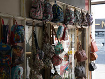 Backpacks in a shop. Colored backpacks in a shop, to use for some details in a line royalty free stock photography