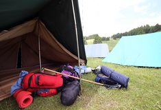 Backpacks and sleeping bags outside the camping tent Royalty Free Stock Photography