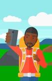 Backpckaer making selfie. Royalty Free Stock Photo