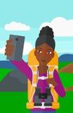 Backpckaer making selfie. Royalty Free Stock Images