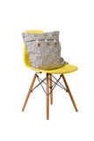 Backrest pillow on yellow color chair isolated on white. Background Royalty Free Stock Image