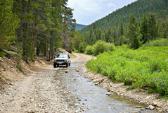 Backroad in Colorado. 4 wheel drive vehicle on a backroad in Colorado stock images
