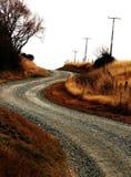 Backroad della ghiaia del paese Immagini Stock