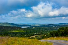 Backroad in the Texas hill country. Backroad in the Texas hill country with water in the distance in the valley royalty free stock image