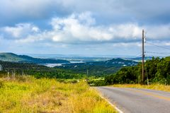 Backroad in the Texas hill country. Backroad in the Texas hill country with water in the distance in the valley royalty free stock photo