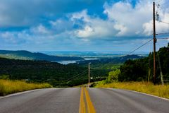 Backroad in the Texas hill country. Backroad in the Texas hill country with water in the distance in the valley stock images
