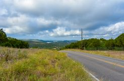 Backroad in the Texas hill country. Backroad in the Texas hill country with water in the distance in the valley stock photos