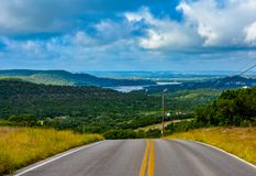 Backroad in the Texas hill country. Backroad in the Texas hill country with water in the distance in the valley stock photography