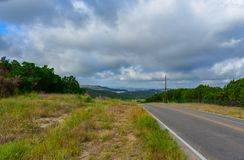 Backroad in the Texas hill country. Backroad in the Texas hill country with water in the distance in the valley royalty free stock images