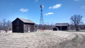 Backroads Michigan. Windmill on abandoned farm Stock Photography