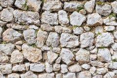 backround από έναν παλαιό τοίχο πετρών στοκ φωτογραφία