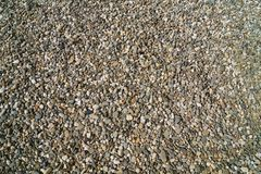 A lot of tiny stones, pebble, gravel, mix of colors. Backround. A lot of tiny stones, pebble, gravel, mix of colors royalty free stock images