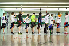 Backs of archers at Championship. MOSCOW - APRIL 2: Backs of archers at Traditional Archery Championship among adults (undergraduate and graduate) of Russian stock photography