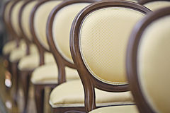 Backs of the chairs in the hall. Backs of the chairs in the concert hall stock photos