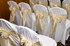 Backs of chairs prepared for wedding marriage Royalty Free Stock Image