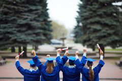Backs of graduates Stock Image