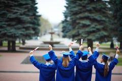 Backs of graduates Stock Photo