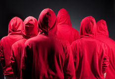 Backs of people in red clothes Royalty Free Stock Photography