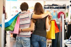 Backs of shoppers. Backs of husband and wife shopping in the mall royalty free stock photo