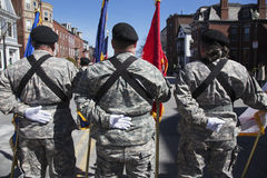 Backs of US Military Honor Guard at ease, St. Patrick's Day Parade, 2014, South Boston, Massachusetts, USA royalty free stock photos