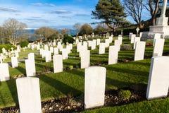 Backs of war graves, military cemetery. Backs of white graves at military naval cemetery, Portland Bill, Dorset, England, UK stock photography