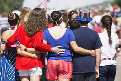 Backs of women pose for picture, July 4, Independence Day Parade, Telluride, Colorado, USA Stock Photo